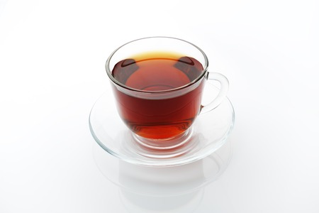tea service: Tea glass cup and saucer isolated at white