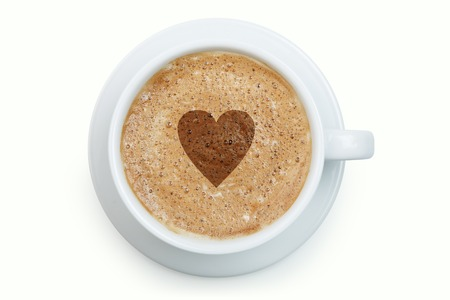 froth: White cup of latte with heart on its froth isolated