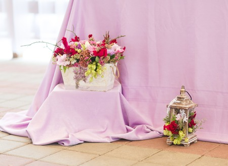 Beautiful flowers bouquets decor in vase and a lantern photo