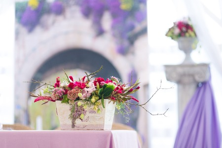Beautiful flowers bouquets wedding decoration in vase photo