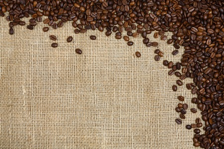 rope border: Coffee beans on sacking background with empty place for text Stock Photo
