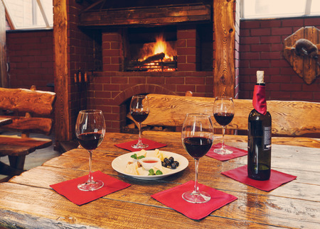 dinner plate: Romantic dinner for two near fireplace - wine and cheese plate