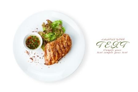 Restaurant food - chicken fillet grilled steak isolated at the white background