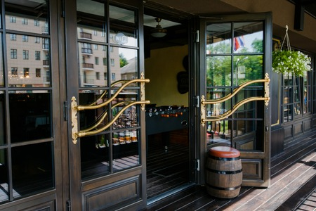 opens: Glazed entrance to the luxurious restaurant - door opens
