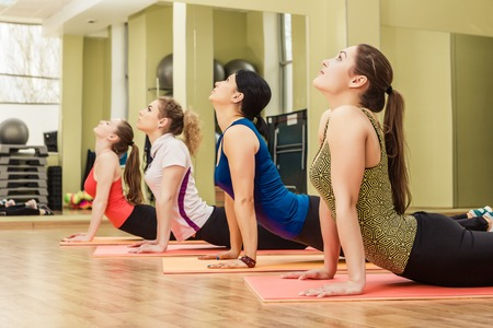aerobics class: Group of women making step aerobics in the fitness class