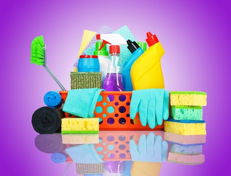 cleaning bathroom: Cleaning supplies in a basket - cleaning and housekeeping concept
