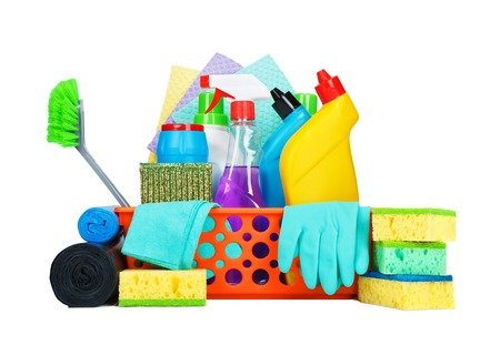housekeeping: Cleaning supplies in a basket - cleaning and housekeeping concept