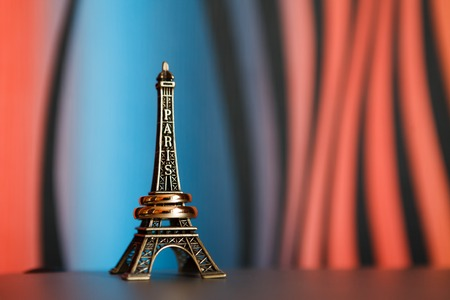 Eiffel tower souvenir with wedding rings on it photo