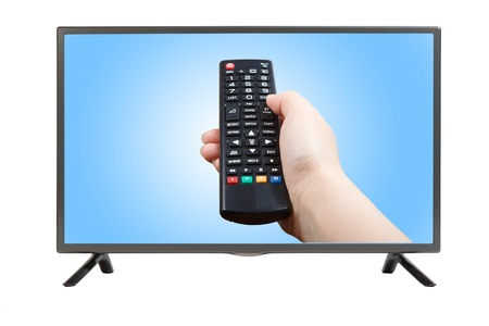 plasma tv: Hand with remote control pointing at modern plasma TV set