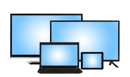 tv sets: computing concept - lots of different monitors and screens of tv sets, laptop, tablet PC isolated at white background with copyspace Stock Photo