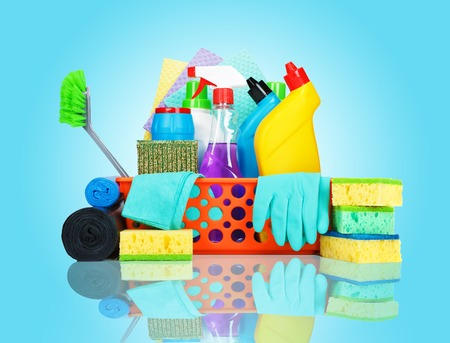 cleaning background: Cleaning supplies in a basket - cleaning and housekeeping concept