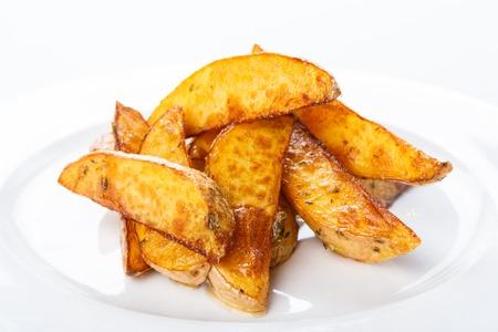 batata: Delicioso crujientes al horno cu�as de patata primer Foto de archivo