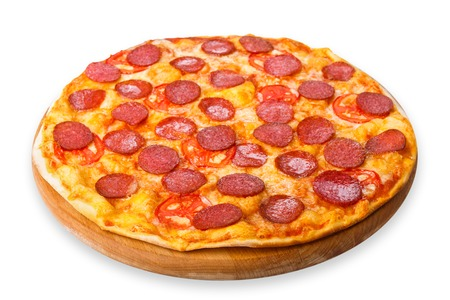 pizza: Delicious pizza with tomatoes and pepperoni - thin pastry crust at wooden round desk isolated at white background