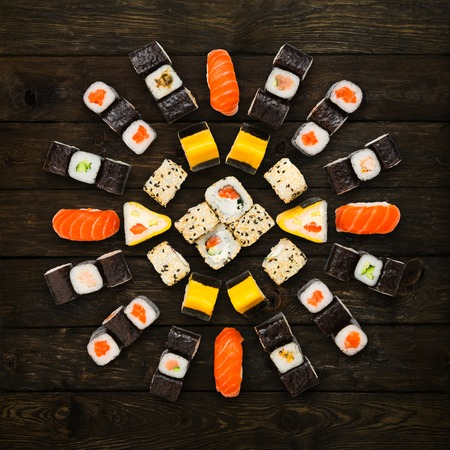 sushi restaurant: Japanese food restaurant delivery - sushi maki california roll platter set isolated at wooden background, above view Stock Photo