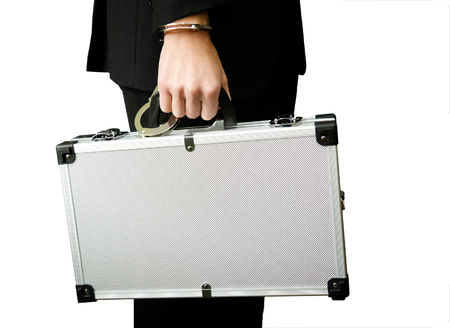 hand guard: Bank finance security concept - businessman or guard hand  in handcuffs closeup holding suitcase with money isolated at white background Stock Photo