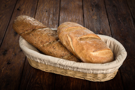 unleavened: Yeast free, no knead, unleavened  healthy organic rye and white wheat homemade bread loafs with sesame in basket on wooden table