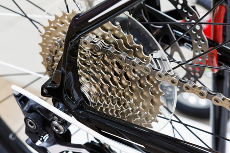 freewheel: Bicycle gears cassette and chain on black mountain bike closeup Stock Photo