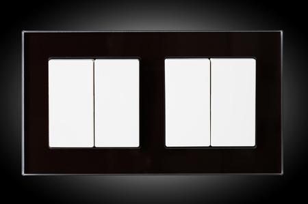 home lighting: Closeup of double white switchers for home lighting isolated at black background Stock Photo
