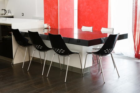 seven persons: Modern dining room or kitchen interior - glass black table for seven persons with plastic chairs