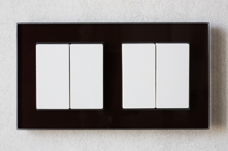 switch: Closeup of double white switches for home lighting on the wall Stock Photo