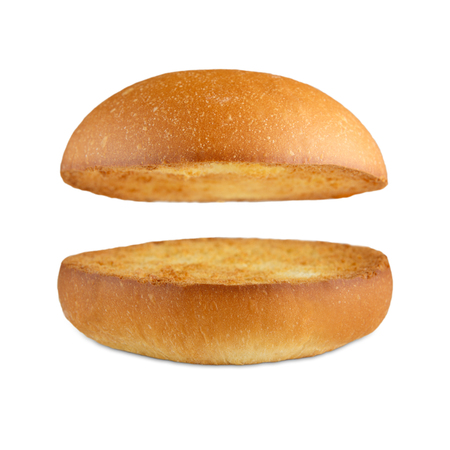 wheat toast: Burger bun empty isolated. American food classic burger round bun isolated at white background. Burger bun without fillings. Roasted toasted hamburger bun layers flying, levitating at white. Stock Photo