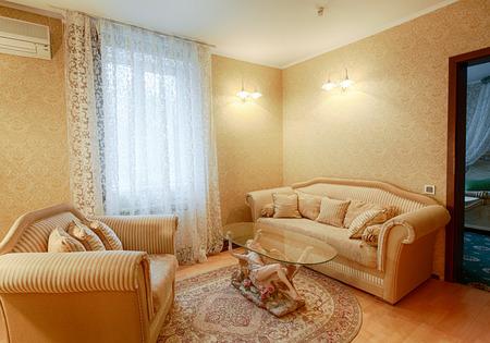 hotel suite: Vintage classic hotel room interior. Luxurious hotel suite premium interior design. Vintage bedroom, elegant and luxurious. Hotel classic interior. Sofa, table, double bed with canopy.