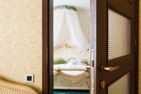 to privacy: Half opened door of a bedroom.