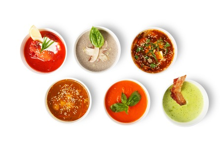 spanish: Variety of soups, restaurant hot dishes, healthy food. Japanese miso soup, asian fish soup, russian borscht, english pea soup, mushroom soup, spanish gazpacho isolated at white. Top view, flat lay.