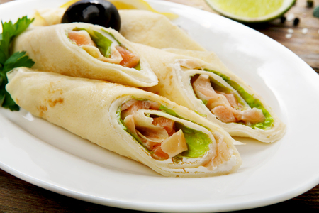 salty: Restaurant food - crepes rolls filled with salty salmon.
