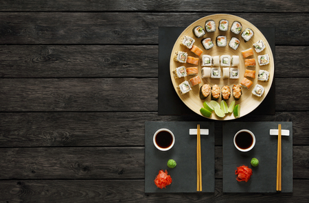 seafood platter: Sushi at rustic wood background and black stone. Top view at black Stock Photo