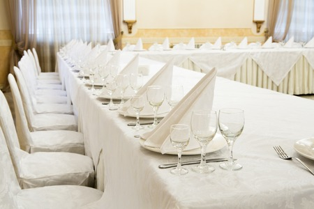 banquet table: Beautifully organized event - served festive white tables ready for guests.