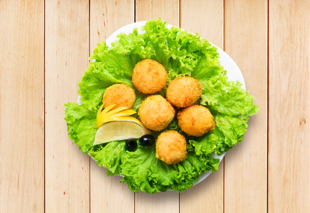 balls deep: Deep fried cheese balls on lettuce.