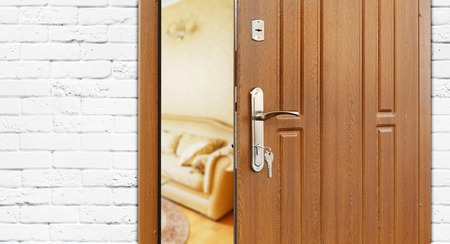 room door: Half opened door to a living room. Stock Photo