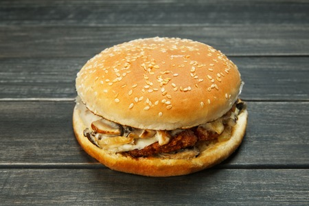 rustic: Cheeseburger on rustic wooden background.