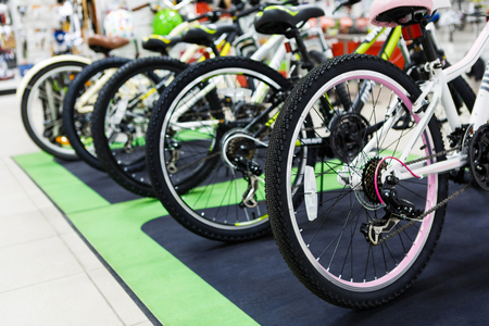 mount price: Row of the mountain mtb bicycles in the sports store, bike shopping