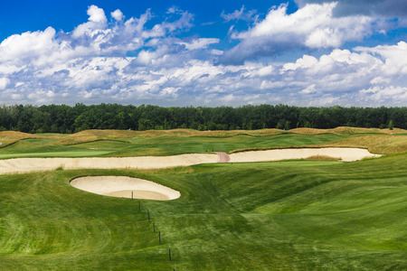 bankers: Perfect golf course. Golf club. Green summer golf course landscape with sand bankers. Golf field beautiful landscape with sand traps. Stock Photo