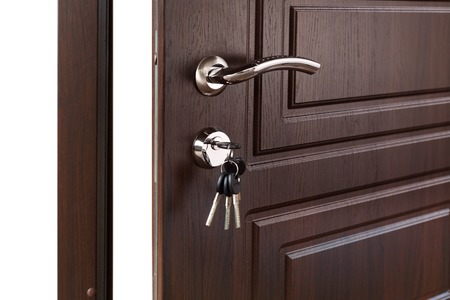 door handle: Open door handle. Door lock with keys. Brown wooden door closeup isolated. Modern interior design, door handle.