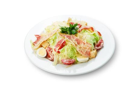 quail egg: Tasty Salad with bacon, parmesan and quail egg, yogurt dressing. Meat salad, Restaurant food, fresh salad. Stock Photo