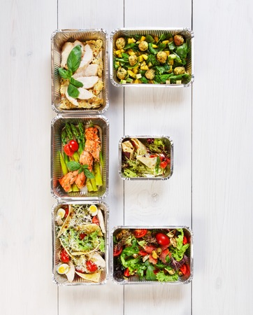 eat right: Eco friendly organic food concept, e letter made from dishes in aluminium lunch boxes.