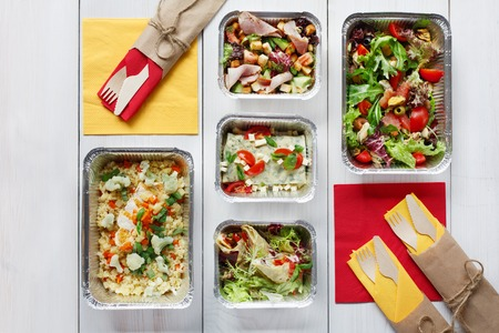 eat right: healthy food take away in aluminium boxes, vegetable salads and meat top view, flat lay at white wood
