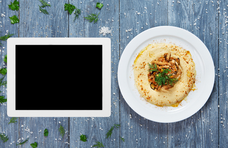 copy space: Hummus plate with copyspace at tablet screen.