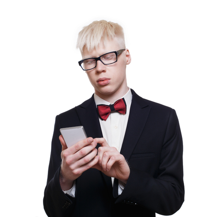 cute guy: Albino young man portrait with smart phone, mobile or cell phone. Stock Photo