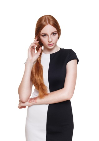 antipode: Portrait of a beautiful redhead woman in elegant black and white dress.