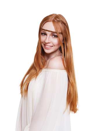 chic woman: Fashion boho chic styled young woman with long red hair smiling, wearing white vintage blouse. Stock Photo