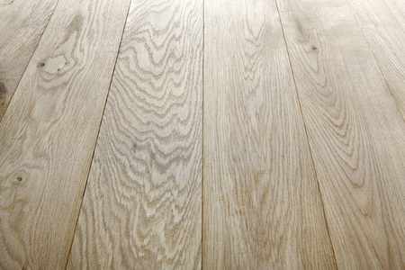 wood flooring: Unpainted oak wood texture and background. Timber oak flooring, wood texture background. Natural wooden background. Unpainted wood planks texture pattern. Wooden surface. Stock Photo