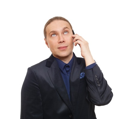skeptic: Annoyed bored man. Mistrustful businessman talking on mobile phone, tired, doubtful, looking skeptic. Annoyed face emotion. Unpleasant call, cell phone conversation. Man in suit isolated at white