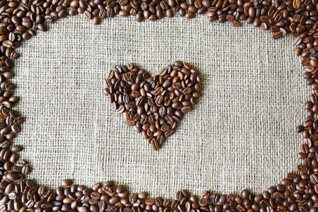 58707619-burlap-texture-with-coffee-beans-heart-shape-background-love-symbol-sack-cloth-canvas-with-copy-spac.jpg