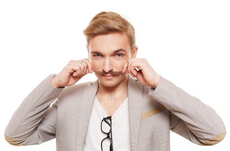 show off: Young man with mustache isolated at white. Handsome guy touch his moustache to show off. Stylish guy with male beauty, seductive person. Nice looking cute hairdresser, metrosexual.