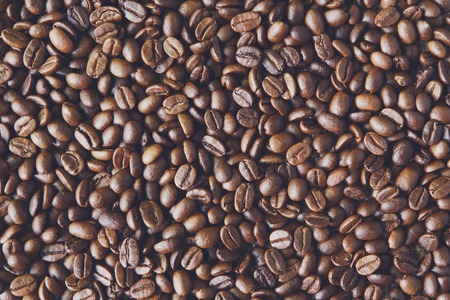 robusta: Coffee Beans background, arabika crop texture. Robusta seeds closeup pattern. Top view, soft color toning