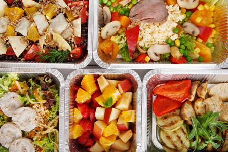 eat right: Healthy food background. Take away of natural organic food in foil boxes. Fitness nutrition, meat, vegetable and fruit salads. Top view, flat lay. Stock Photo